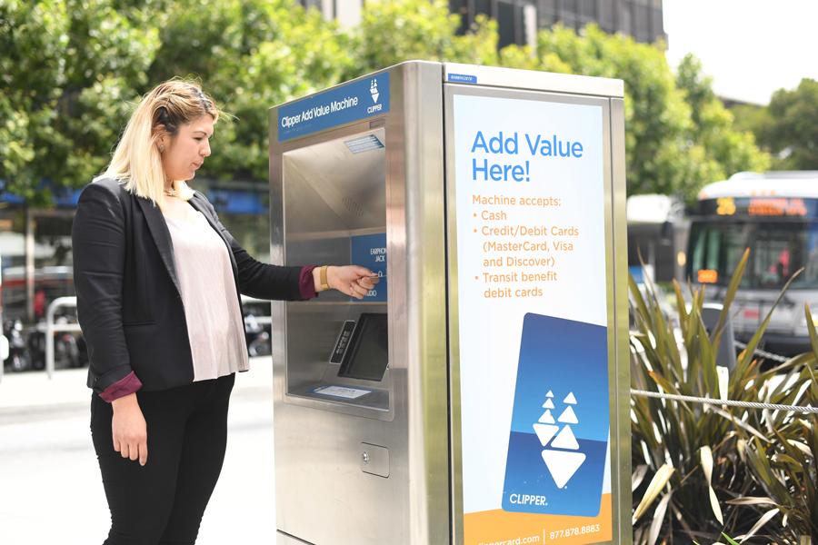 Woman at a Clipper Add Value Machine